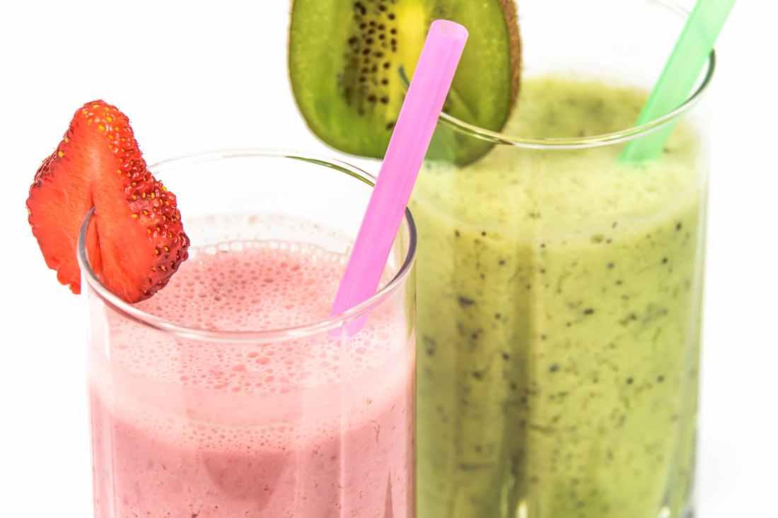strawberry milkshake beside kiwi shake